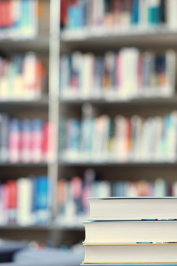 Stack of books in a library. Stack of books on a table in a library, shelf, read, white, education, study, school, learn, yellow, information, colledge, degree stock images