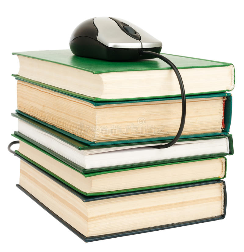 Stack books and mouse. Isolated royalty free stock photos