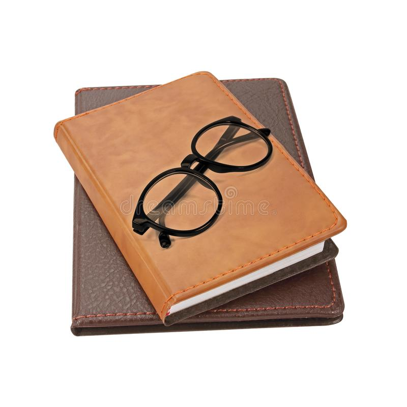 Stack of books with a pair of eyeglasses on top stock image