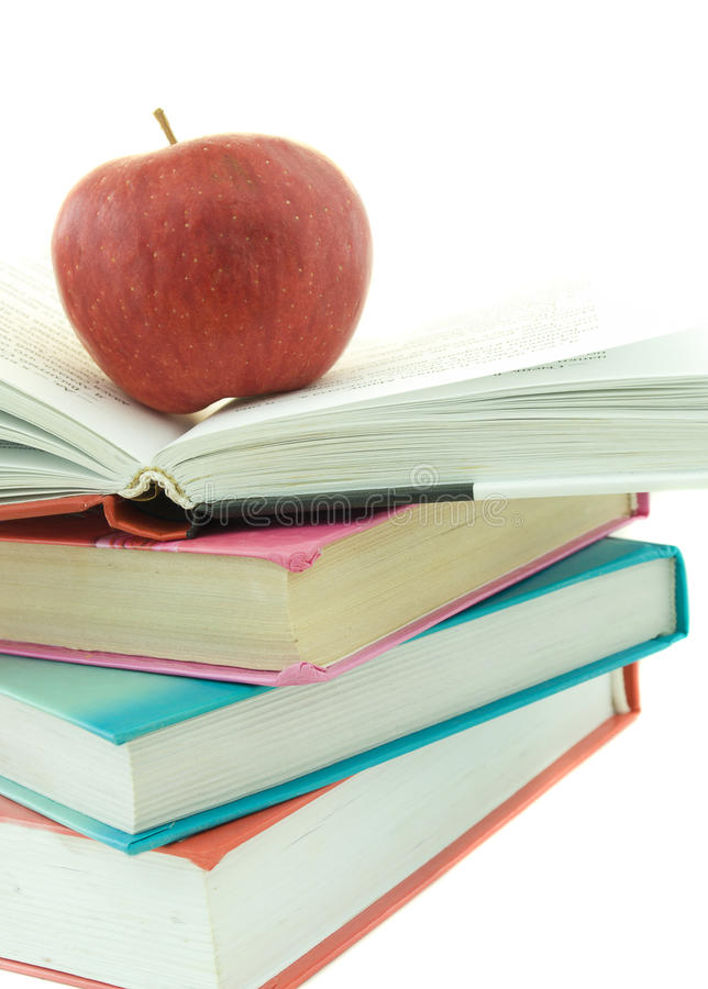 Stack of books with red apple stock photos
