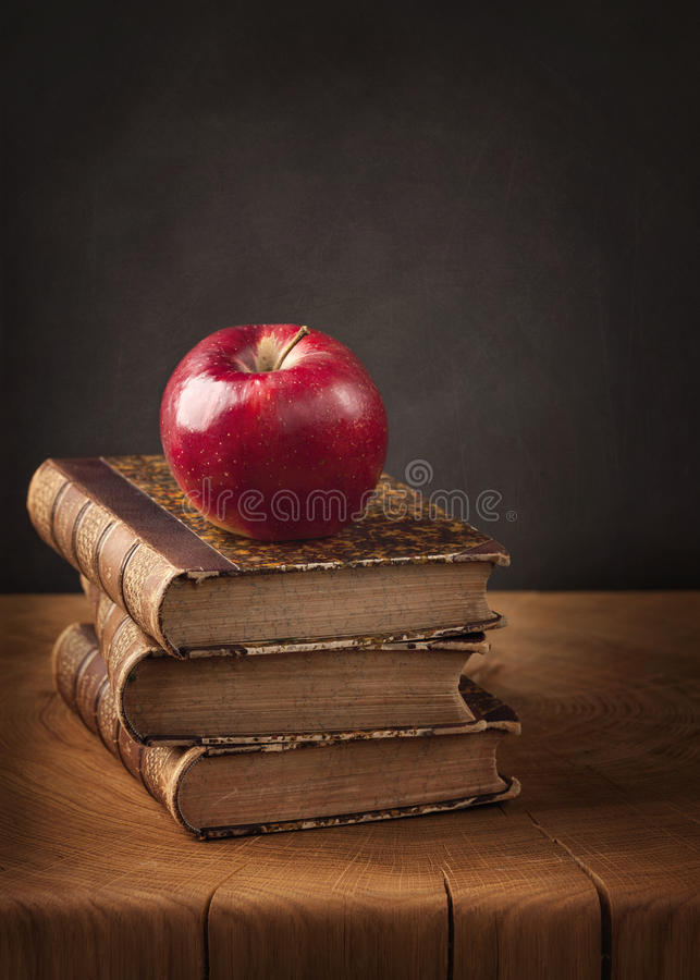Download Stack Of Books And Red Apple Royalty Free Stock Photography - Image: 32937757