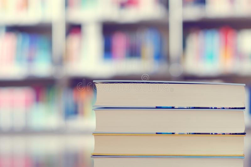 Stack of books in a library. Stack of books on a shelf in a library, read, white, education, study, school, learn, yellow, information, colledge, degree, student stock photos