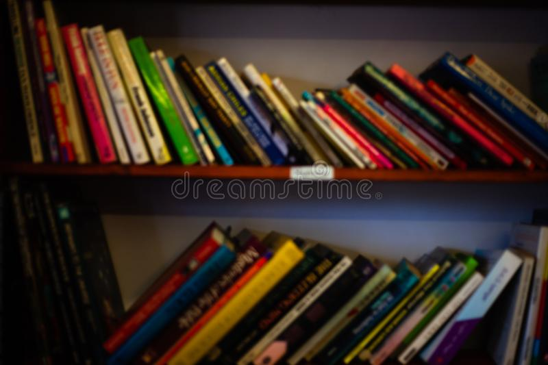 Stack of books on the shelves. Learning concept with library books on the shelves. Colorful book covers in the wooden cabinet. Sch. Stack of books on the shelves stock photography