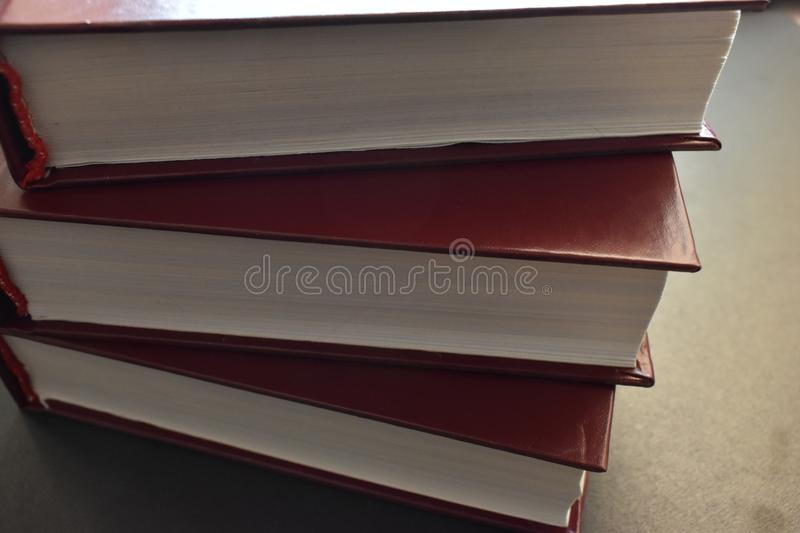 Stack of books, white sheets. royalty free stock image