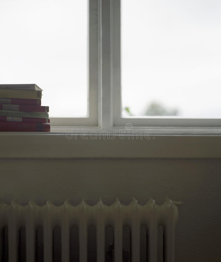 Stack Of Books On Windowsill stock image