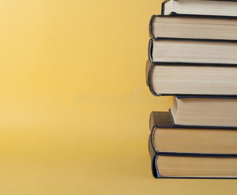 Stack of books on yellow background. Education concept. Back to school. royalty free stock photo