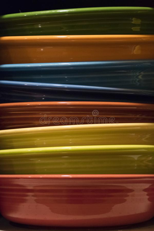 COLORFUL STACKED BOWLS AT ANGLES. A stack of bowls sits on top of each other royalty free stock photos