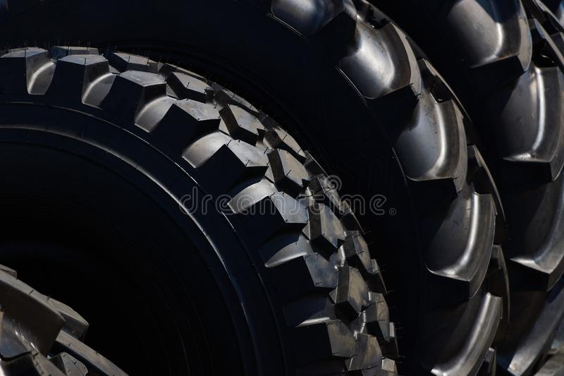 Stack of brand new tractor tires background, close-up stock photos