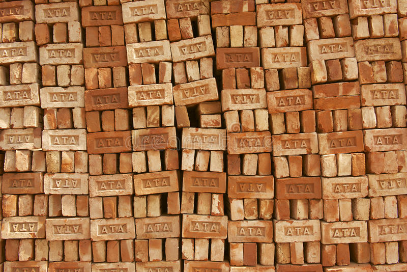 Stack of bricks for sale in Dhaka, Bangladesh. DHAKA, BANGLADESH - FEBRUARY 19, 2014: Stack of bricks for sale on February 19, 2014 in Dhaka, Bangladesh. Low stock photos