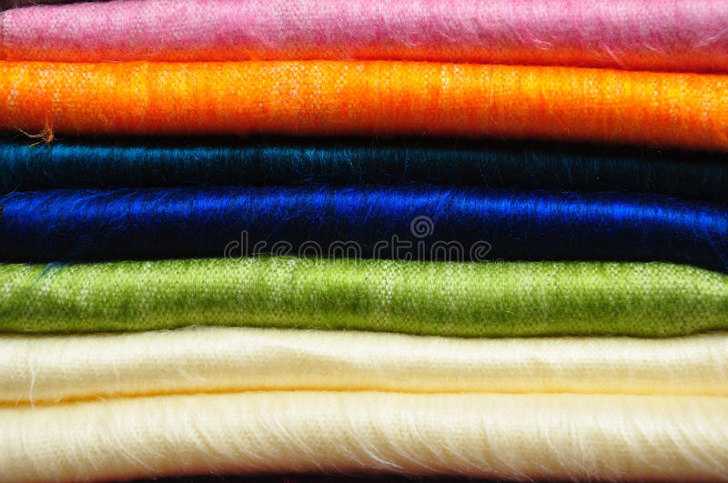 Stack of brightly coloured alpaca blankets stock photos