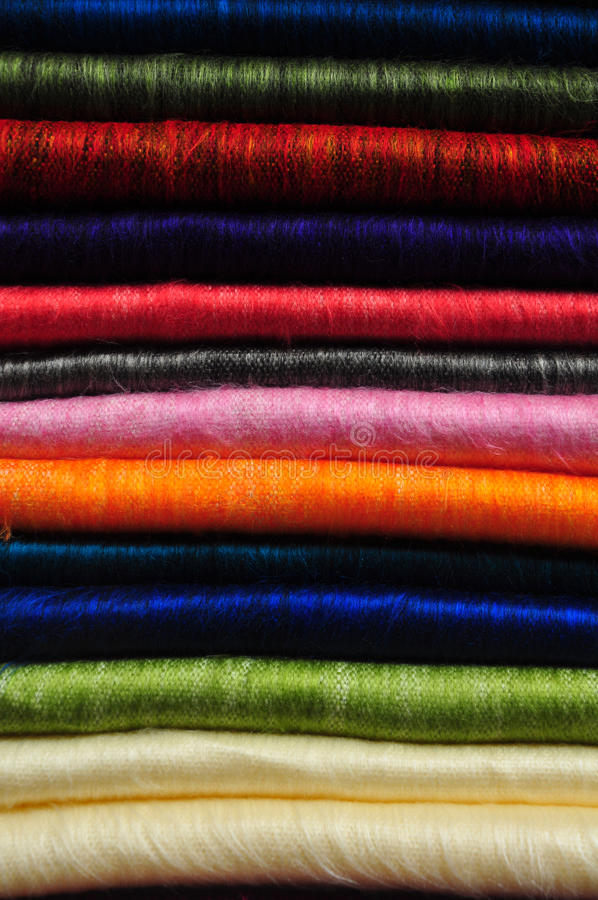 Stack of brightly coloured alpaca blankets stock photography