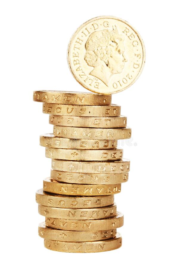 Stack of British one pound coins stock images