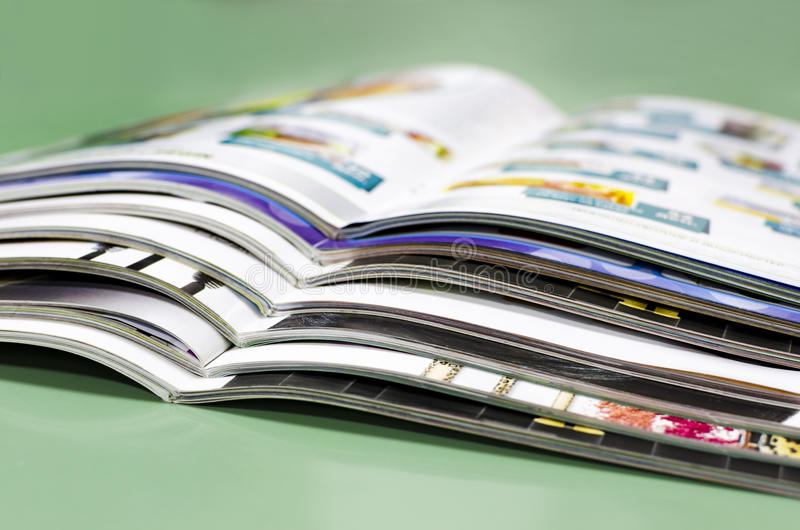 Stack of brochures in print plant. Abstract stack of brochures on green background royalty free stock images