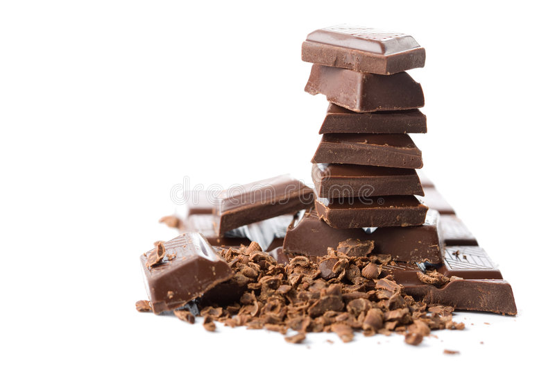 Stack of broken chocolate isolated stock photo