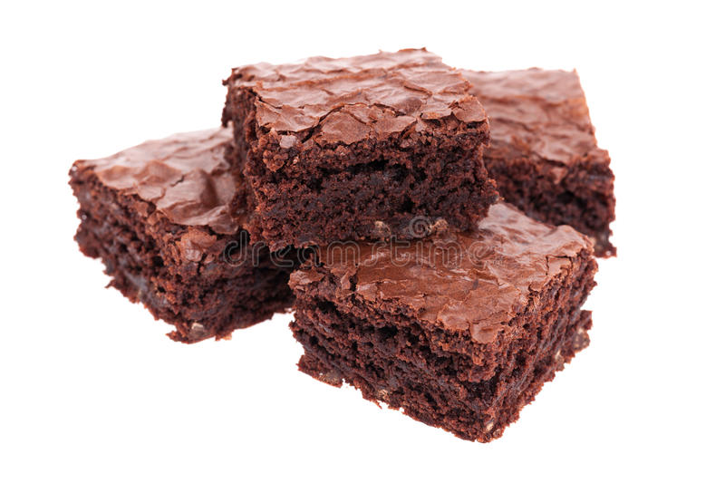 Stack of brownies. A stack of fresh brownies isolated on white royalty free stock images