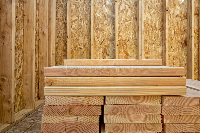 Stack of building lumber in construction site royalty free stock photo
