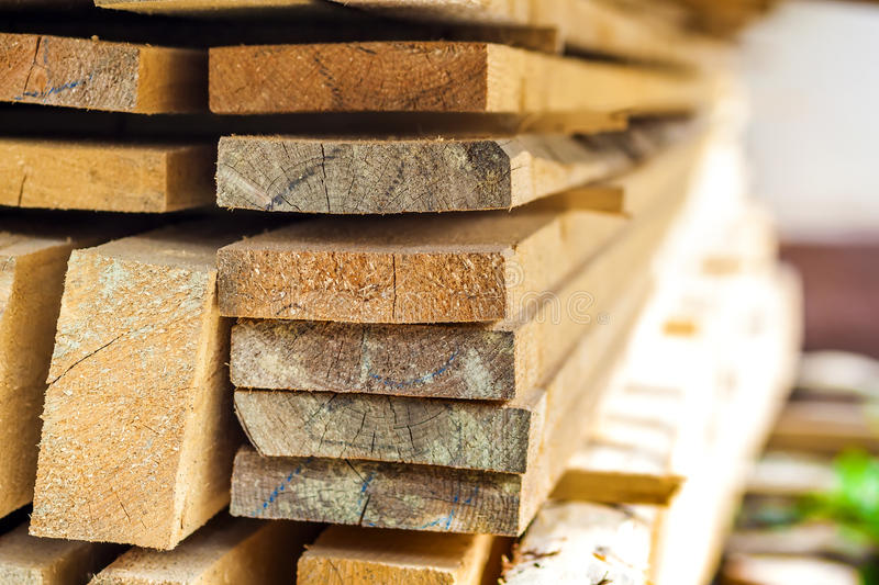 Stack of building lumber at construction site with narrow depth royalty free stock photography