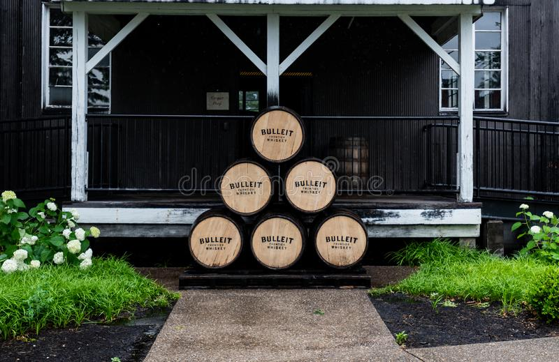 Stack of Bulleit Bourbon Barrels Outside Building. Louisville, United States: June 11, 2018: Stack of Bulleit Bourbon Barrels along the Kentucky Bourbon trail at stock photos