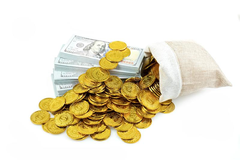 Stack bundles of 100 US dollars banknotes and gold coin in treasure sack on white background stock photos