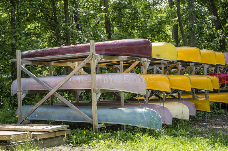 Stack of Canoes. Bunch of colorful canoes ready for rent royalty free stock photos