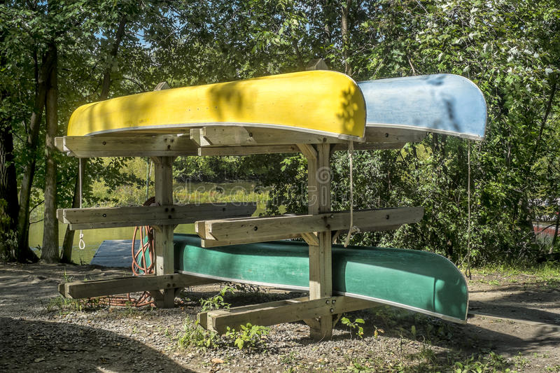 Stack of Canoes. Bunch of colorful canoes ready for rent stock images