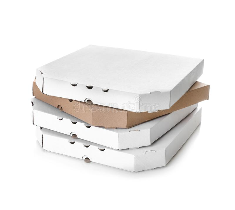 Stack of cardboard pizza boxes on white. Mockup for design. Stack of cardboard pizza boxes on white background. Mockup for design royalty free stock photo