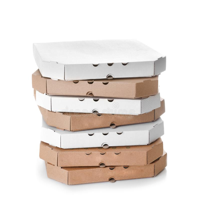 Stack of cardboard pizza boxes on white. Background royalty free stock photography