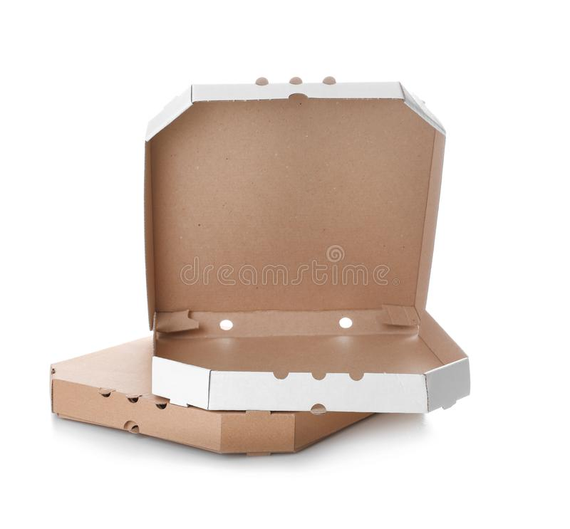 Stack of cardboard pizza boxes on white. Background stock photography