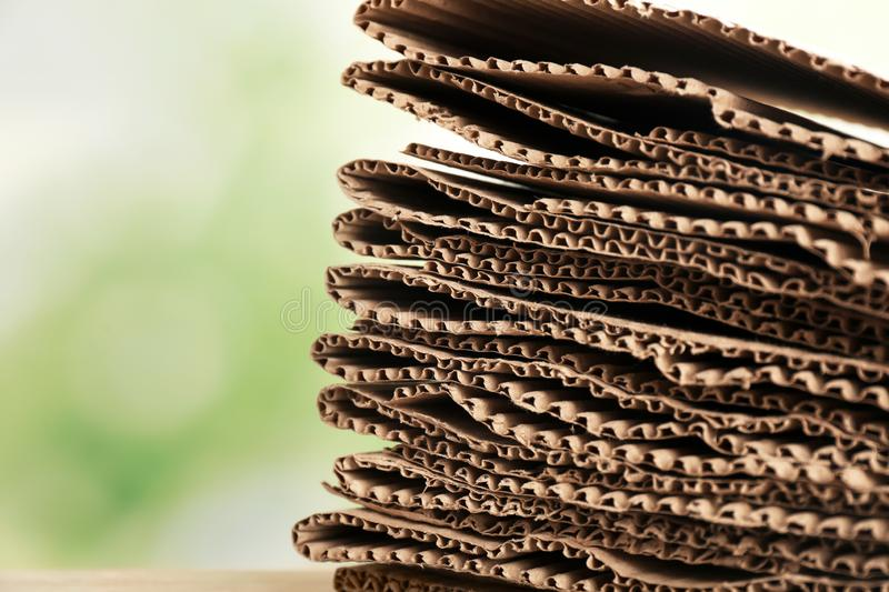 Stack of cardboard for recycling on blurred background, closeup. Space for text royalty free stock images