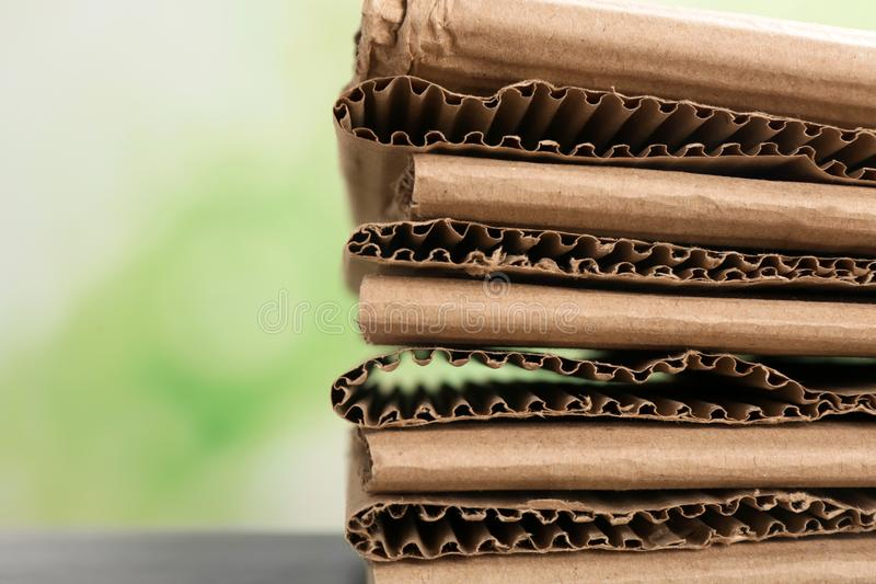 Stack of cardboard for recycling on blurred background, closeup. Space for text stock images