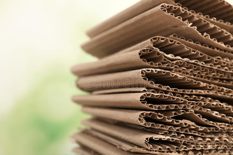 Stack of cardboard for recycling on blurred background. Closeup stock photos