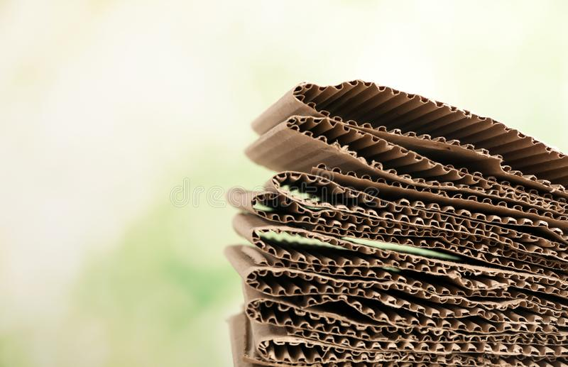 Stack of cardboard for recycling on blurred background. Space for text royalty free stock photos