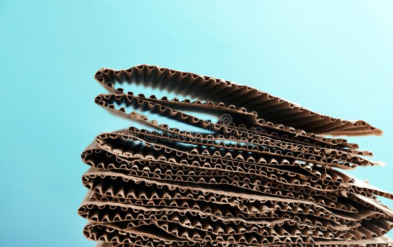 Stack of cardboard for recycling. On color background stock images