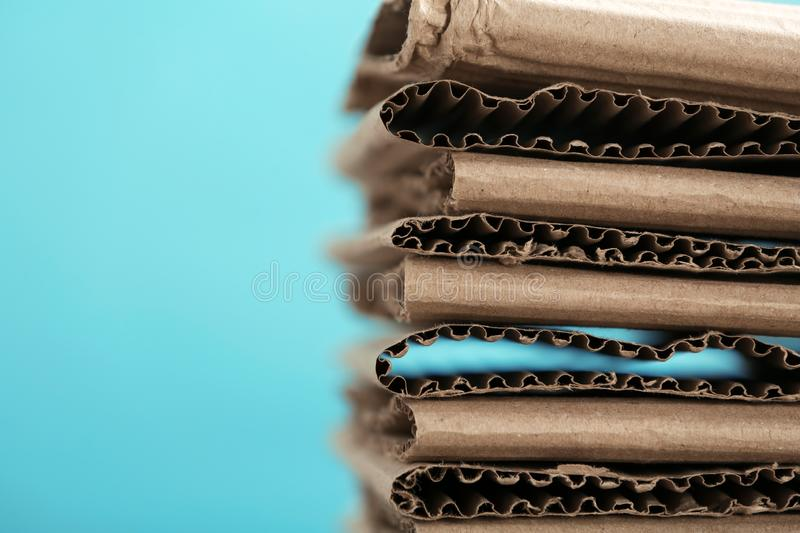 Stack of cardboard for recycling on color background, closeup. Space for text royalty free stock images