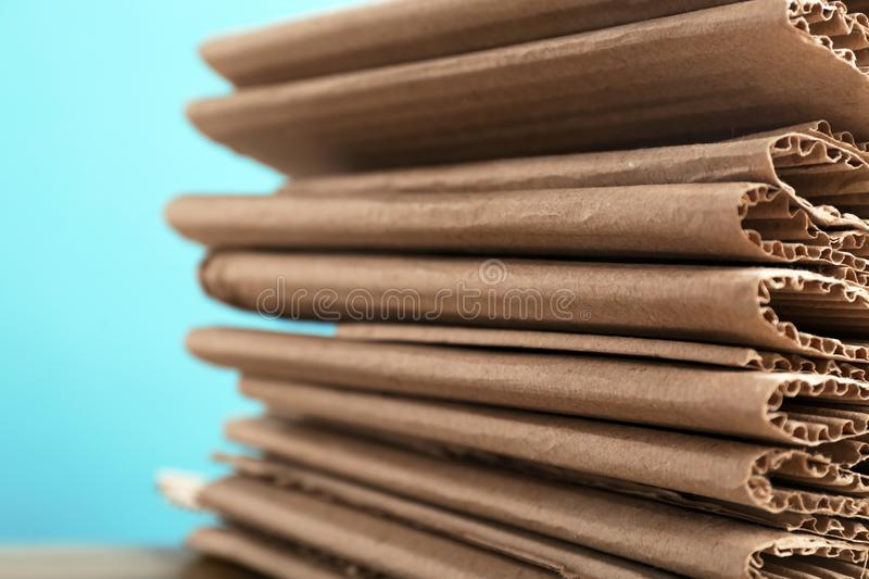 Stack of cardboard for recycling on color background. Closeup royalty free stock images