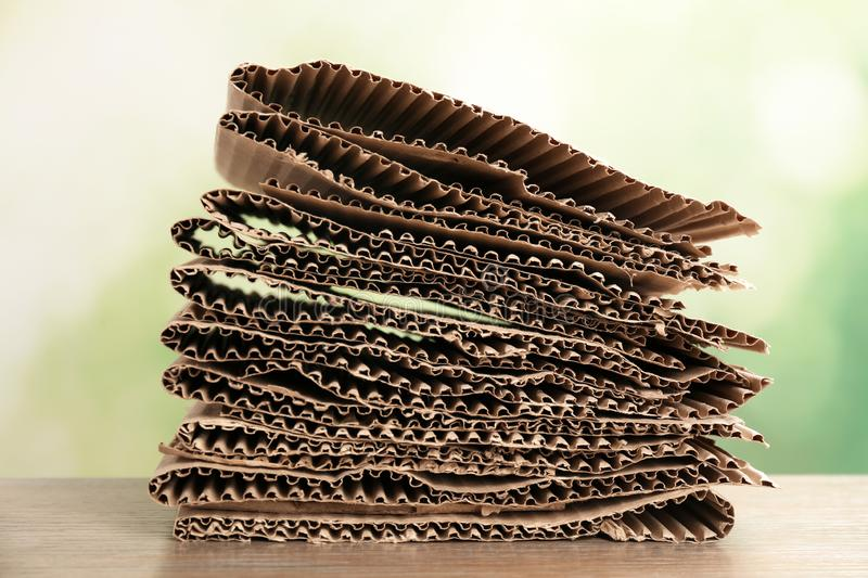 Stack of cardboard for recycling on table. Against blurred background stock photo