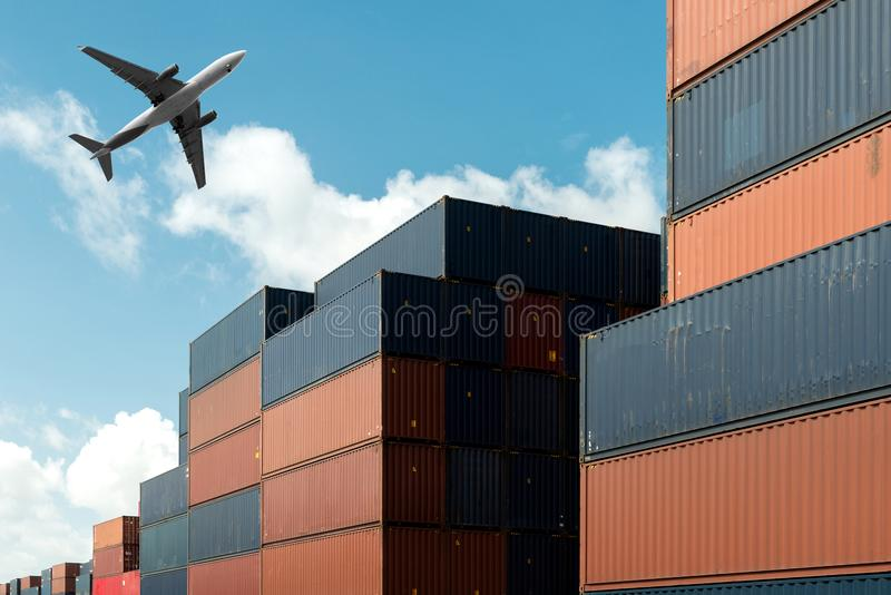 Stack of cargo containers with cargo airplane at import and expo stock photography