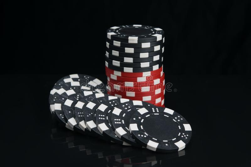 Stack Of Casino Chips In Black And Red, On A Dark Background, With Reflection Stock Image - Image of blackjack, color: 138510391