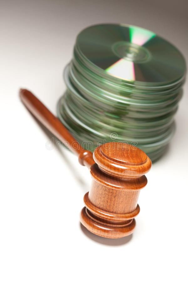 Stack of CD Rom or DVD Discs and Gavel stock image