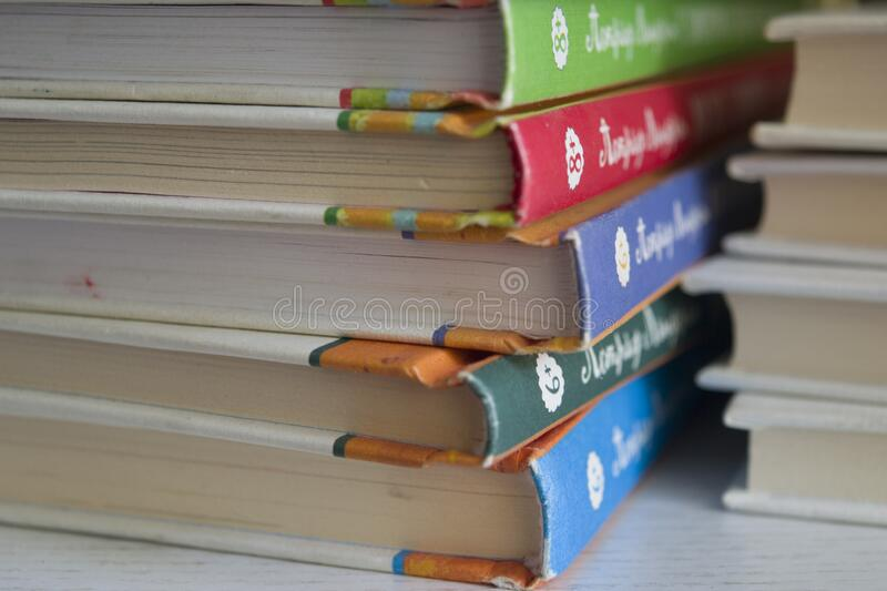 Books for children. A stack of children`s books on the shelf. great when people love to read, and good when they read from childhood stock photos