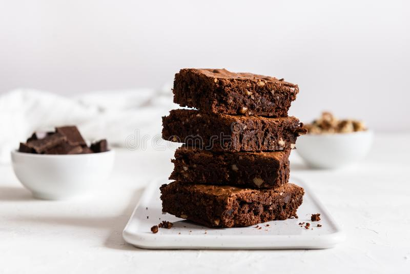 A stack of chocolate brownies on white background, homemade bakery and dessert. Bakery, confectionery concept. Side view royalty free stock photos