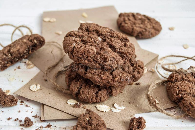 A stack of chocolate cookies on craft paper royalty free stock photo