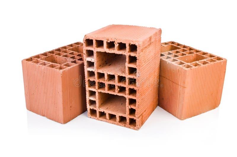 Stack of clay bricks royalty free stock photography