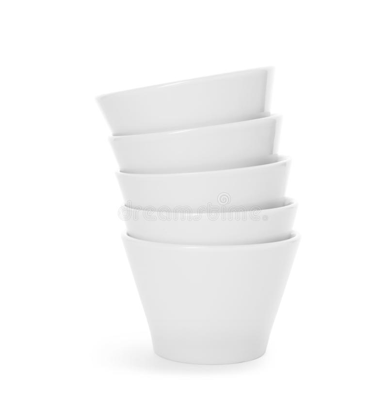 Stack of clean bowls on white background. Washing dishes royalty free stock photography