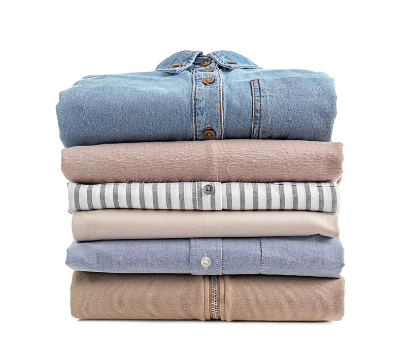 Stack of clean clothes. On white background royalty free stock photos