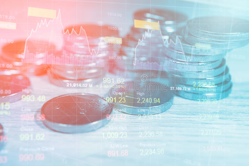 Stack coin money finance and banking with profit graph of stock market trade indicator financial royalty free stock image