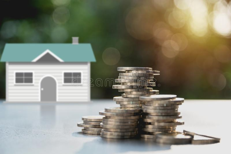 Stack of coin money with house. Save money for a house concept.  royalty free stock photo