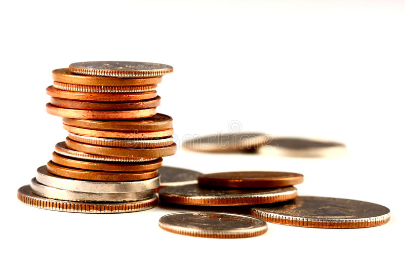 Stack of coins. A stack of different coins royalty free stock photos