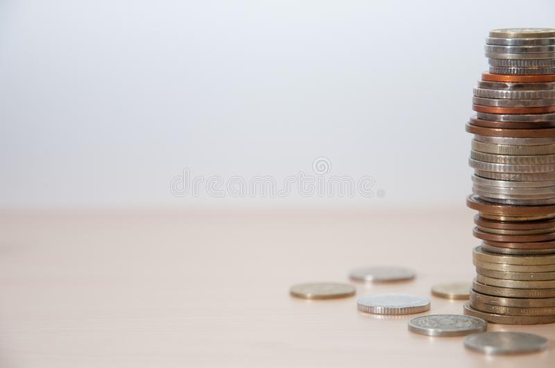 A stack of coins of different countries, color, dignity and size on the right at the edge of the picture. A stack of coins of different countries, color stock image