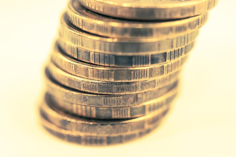 Stack of coins macro. Rows of coins for finance and banking concept. Economy trends background for business idea. royalty free stock image